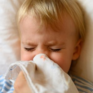 The Little Boy Blows His Nose In His Handkerchief Runny Nose In A Child The Concept Of Colds Allergy T20 Ywj7we.jpg